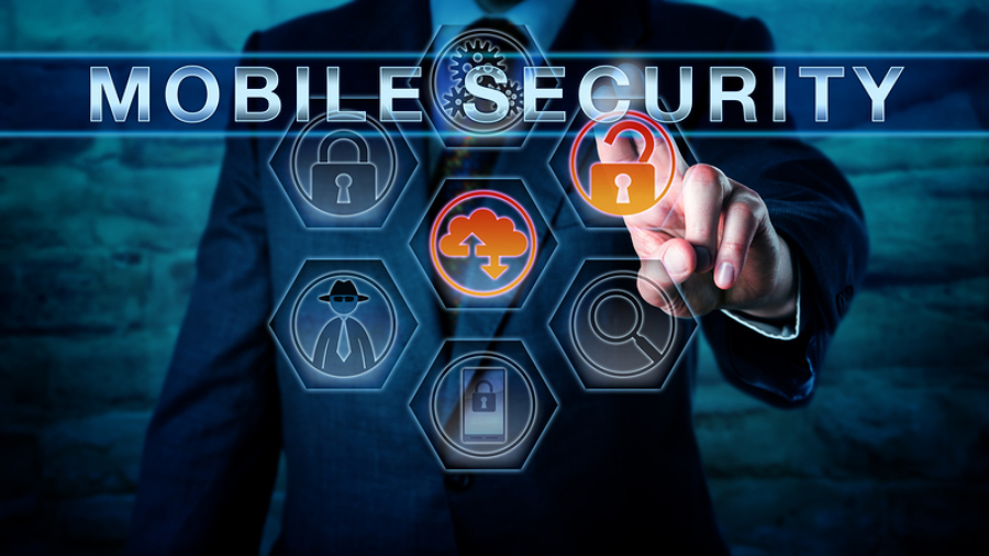 Male Caucasian industry professional pressing MOBILE SECURITY on an interactive touch screen with virtual forensics tool icons. Cyber concept for mobile phone security. Solid stone wall background.