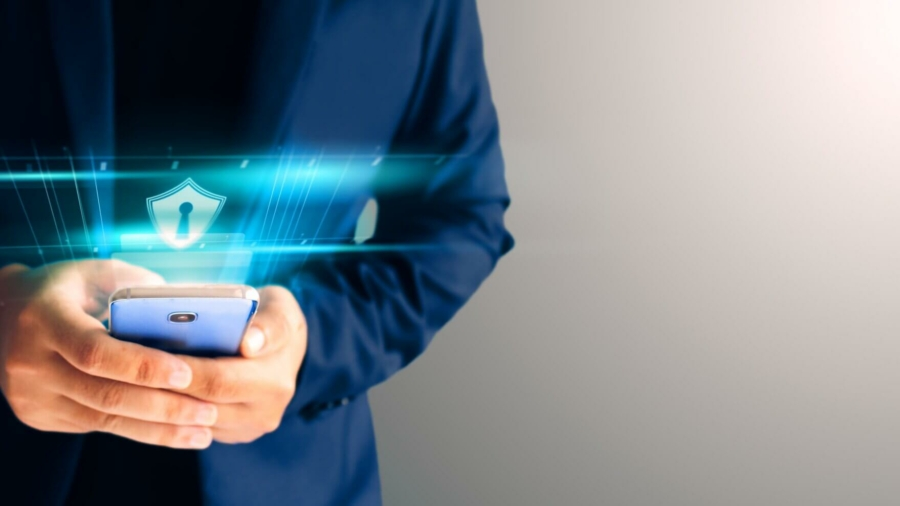 close-up-business-man-formal-blue-suit-use-hold-smart-phone-in-the-dark-and-copy-space-use-finger-print-unlock-smart-phone-security (2) (1)